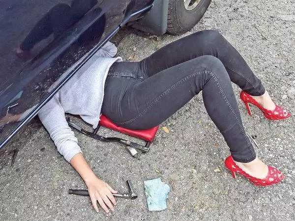 Men, beware! This 'red hot' woman quit her job to become auto MECHANIC wearing red stilettos (photos, video)
