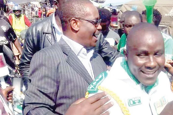 Governor Kidero rides with Jaro Soja on his motorbike