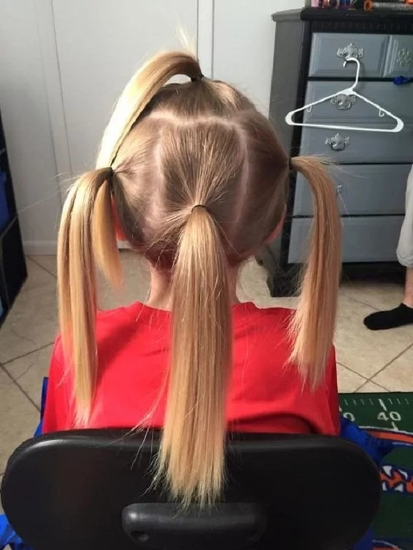 Hair tied in ponytails