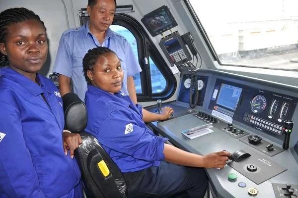 Train drivers Elizabeth Wanjala (left) and Shalom Njeri with their instructor Lu Zhili