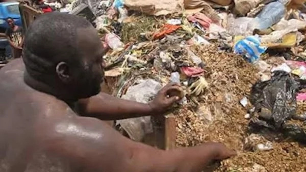 The unidentified man pictured rummaging through the dump. Photo: gistplanet365.com