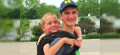 Teen carries brother with cerebral palsy 111 miles to raise awareness