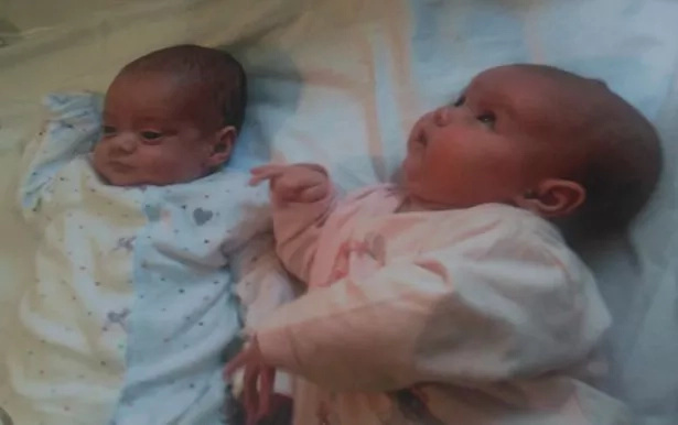 Miracle twin sisters born 87 days apart, and who doctors said would not survive, report to school