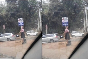 Young SEXY lady begs for job besides busy Nairobi highway(Photos)