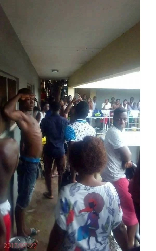 Campus girl walks out of male hostel to standing ovation from fellow students after a 2-hour noisy drill by lover (photos)