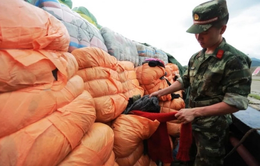 Chinese police seize 549 tons of secondhand clothes