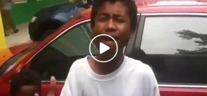 This singing Pinoy street kid surprised the man recording the video when he started singing the first line...that was epic!