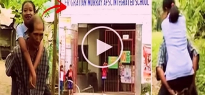 This 63-year-old Pinoy farmer in Bacolod City went viral for carrying his sick daughter to school every day. Watch his inspiring video!