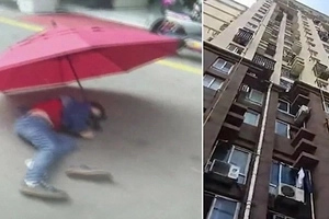 Boy jumps off 10th-storey window using UMBRELLA as parachute and survives (photos, video)