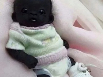Shocking, but is he real? Meet the darkest baby in the world