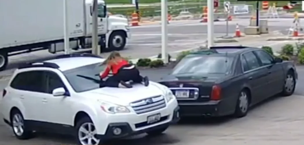 You are not taking it! Daring woman WRESTLES her SUV from carjacker by jumping on windshield (photos)