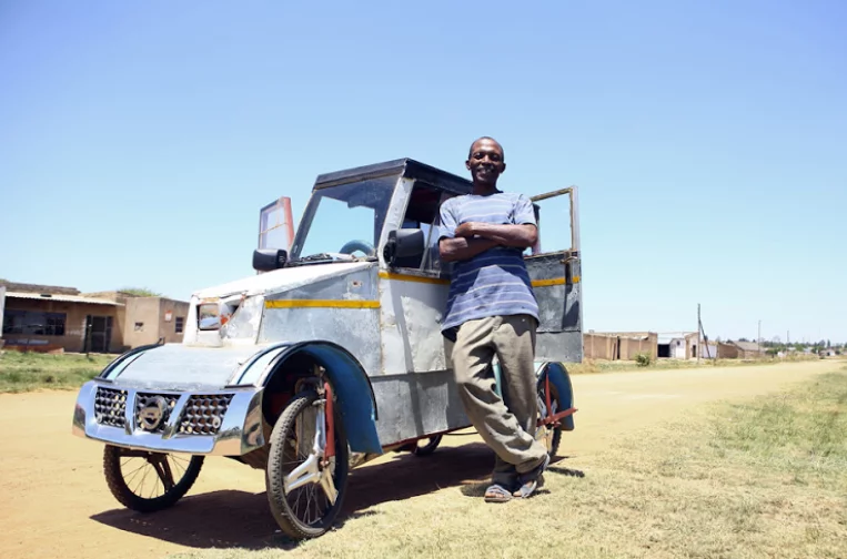 I had no money for transport - Man builds pedal car from scrap to take children to school