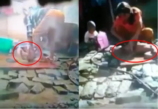 Child cries in pain as mother abuses him while giving him a bath