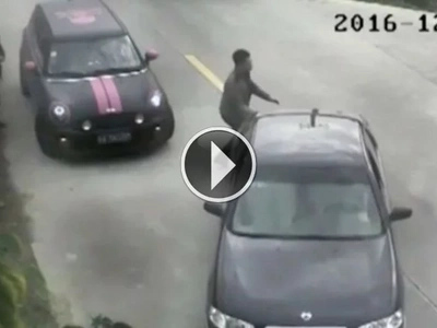 Watch as man reverses his car into river after slamming on accelerator instead of brake (video)