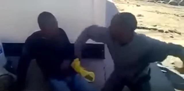 Two thieves are made to beat each other as punishment