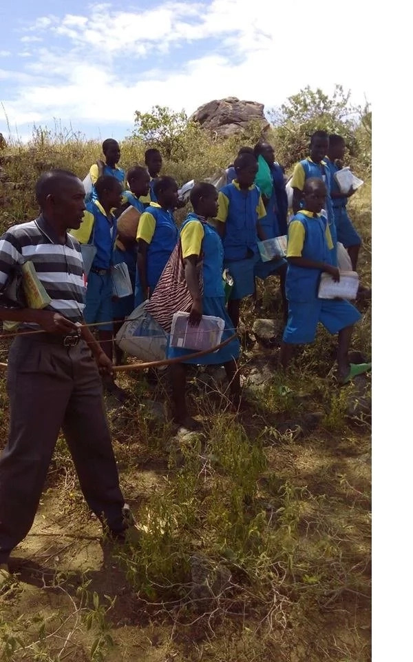 Elgeyo-Marakwet teacher escorts his pupils home with bows and arrows