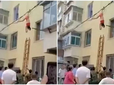 Half-dressed woman filmed dangling from electric cables after lover's wife arrived home early
