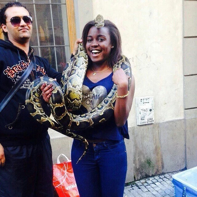 A creepy photo of Mudavadi's daughter playing with a big dangerous snake