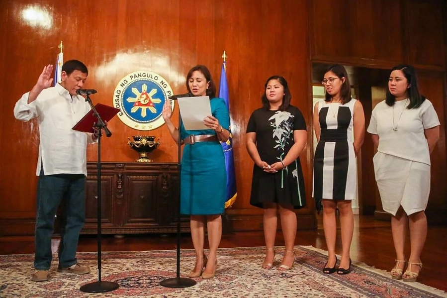 Leni takes oath as new HUDCC chief