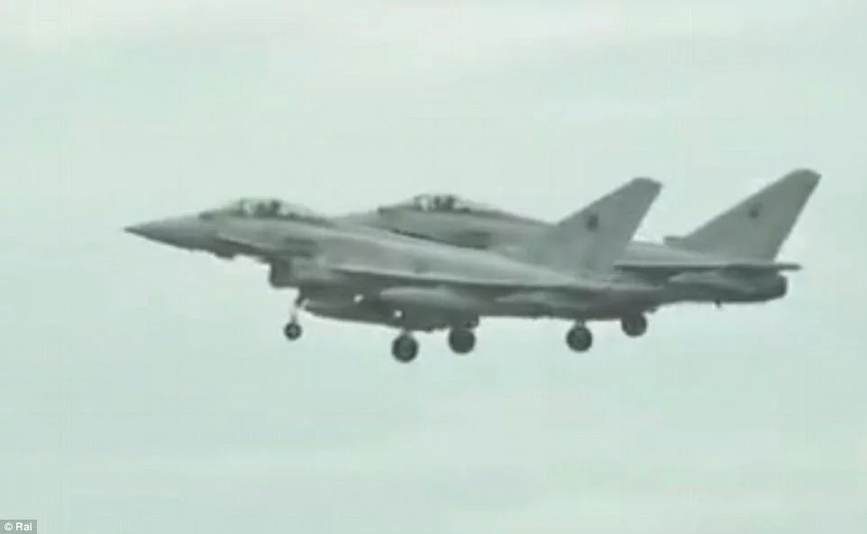Two of the six fighter jets escorting their private jet