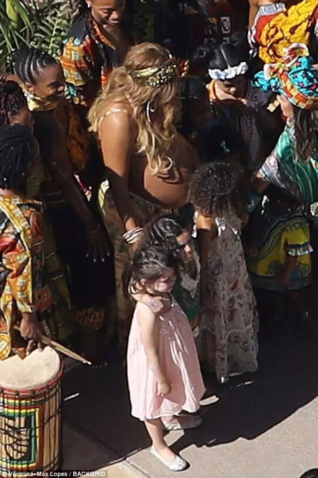 Bursting baby bump! Heavily pregnant Beyoncé celebrates African-inspired baby shower (photos, video)