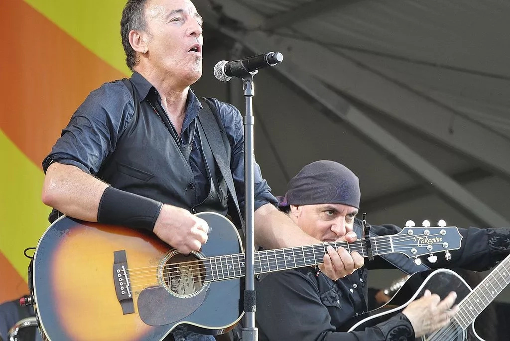 Bruce Springsteen performing on stage | Photo Getty Images