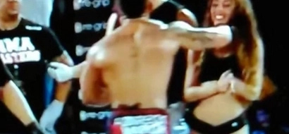 Sore Loser MMA Fighter Punches Ring Girl Right In The Kisser