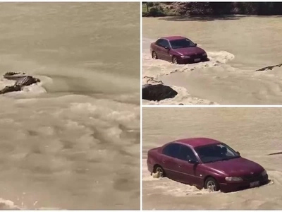 Watch funny moment car honks at huge crocodile that blocked flooded road