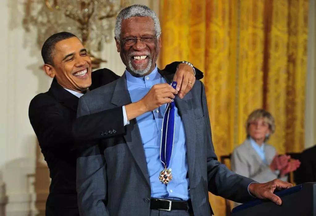 Russell receives his medal from then President Obama in 2011. Photo: AP