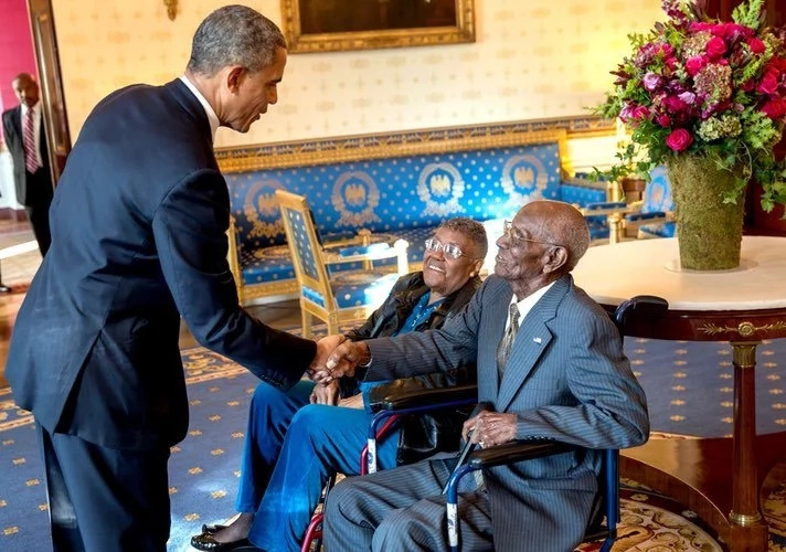 Overton pictured with former US President Barack Obama at a Veterans' Breakfast event at the White House in 2013