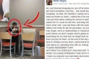A woman saw a boy eating alone. She came closer and asked about his parents, the child looked at her sadly.