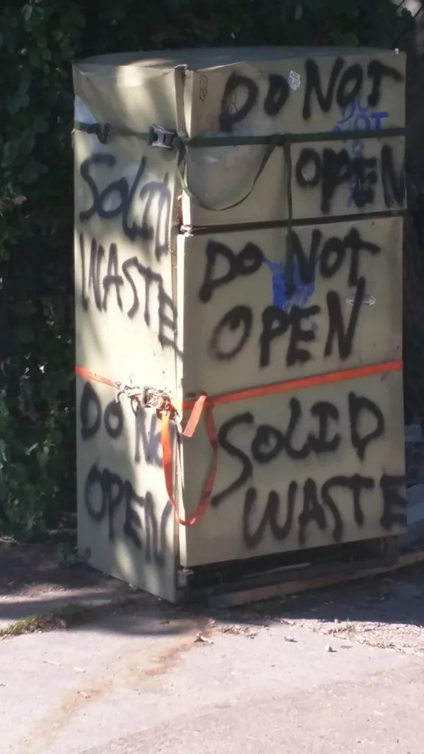 Someone left this fridge in the street 7 years ago. These guys decided to open it, ignoring the 'Do not open' sign on its side