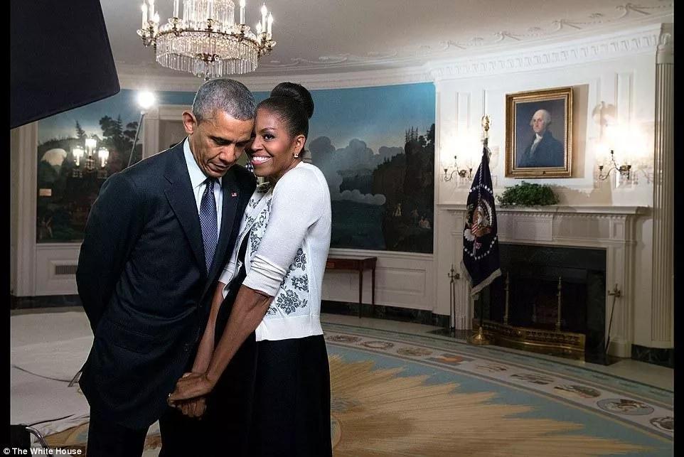 Michelle Obama snuggles against Barack Obama at the White House. Photo: The White House.