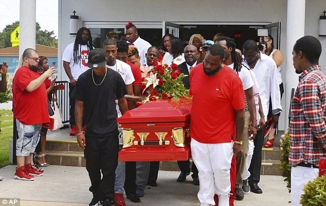 Hundreds of mourners attended Dunn's funeral. Photo: AP