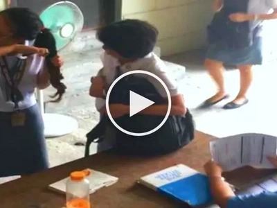 Daring Filipina student cuts her own dyed hair to avoid school violation penalty