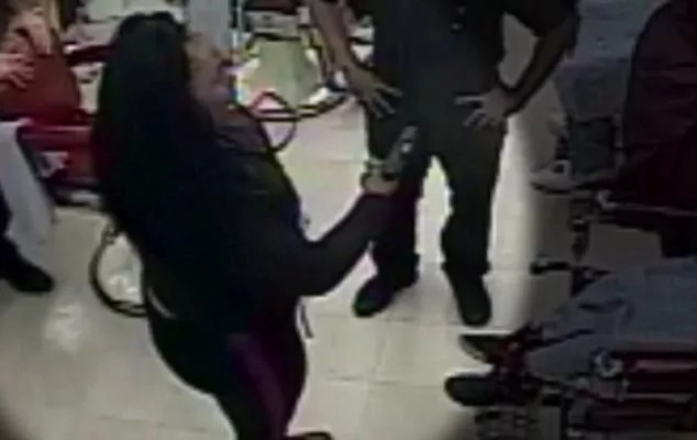 "CCTV footage captures woman taking out a GUN on her son's barber ""for taking too long"" (video)"
