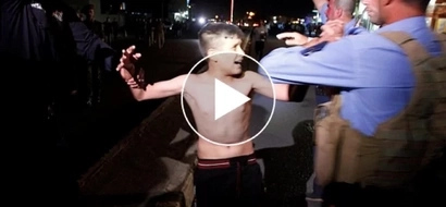 VIDEO: Iraqi police SAVES this ISIS child from blowing up himself!