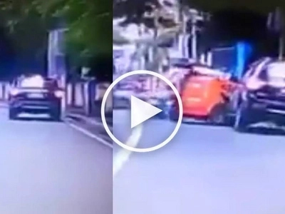 SUV collides with tricycle & causes passenger to fall off