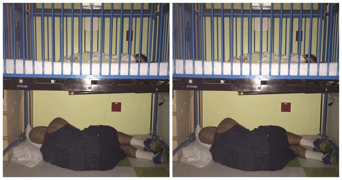 Father of the year! Devoted dad sleeps UNDER son's hospital crib who has asthma (photos)