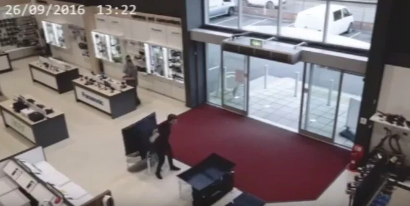 CCTV Captures A Clumsy Customer Hilariously Breaking 4 Flatscreens TVs