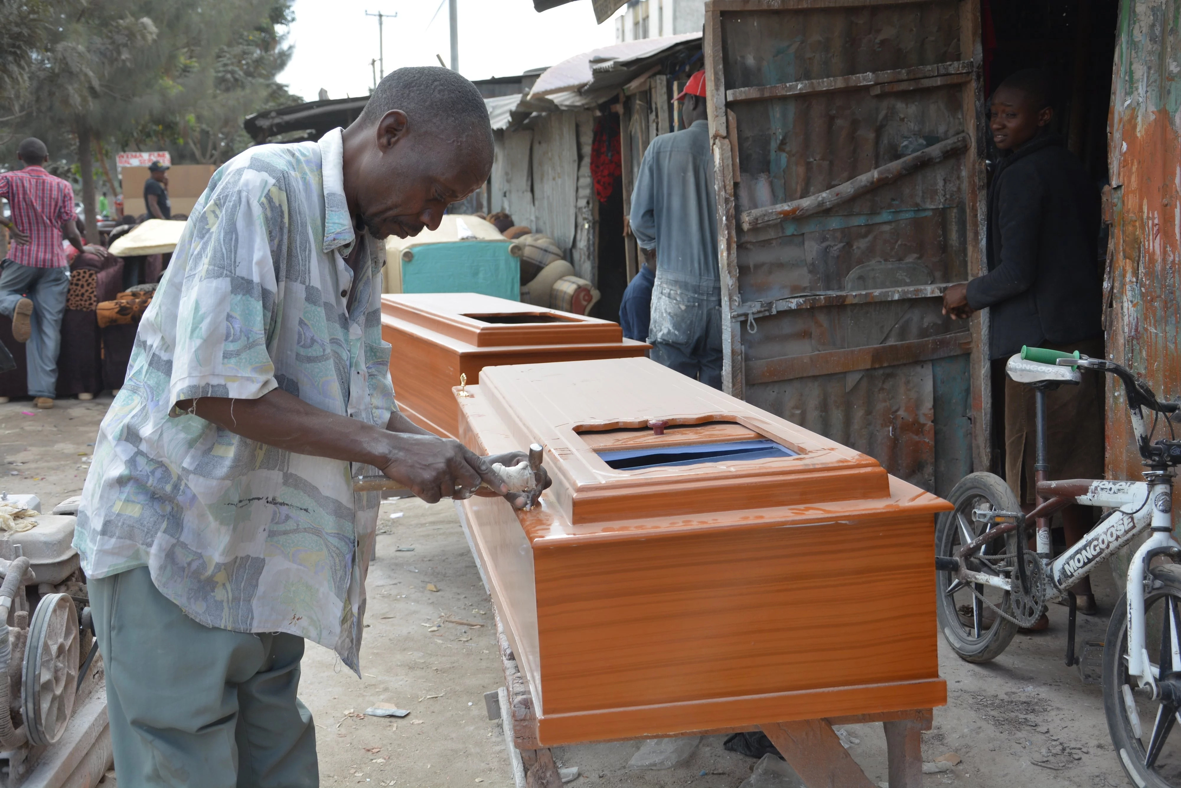 Kenyan coffin maker on tribes that buy expensive coffins