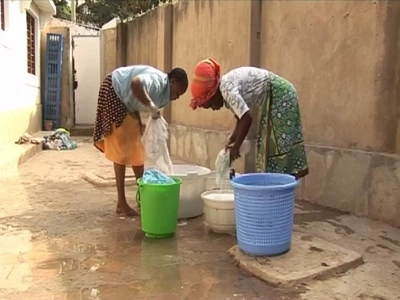 Sad story of university student washing clothes for a living