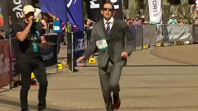 Whitaker ran the marathon in a three-piece suit. Photo: Daily Mail