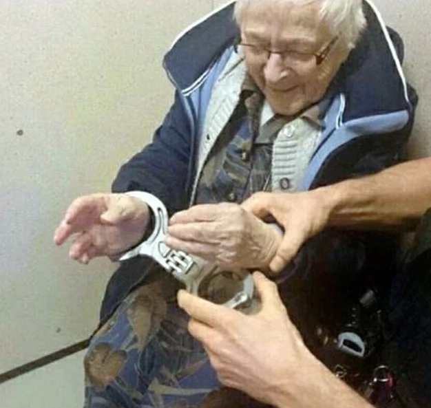 Police handcuff and lock 99-year-old woman in cell because she WANTED to be arrested (photos)