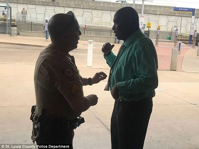 White cop helps black man tie his tie as he goes for job interview amid acrimonious anti-police protests