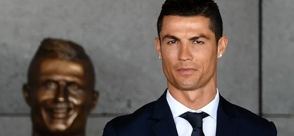 Cristiano Ronaldo poses with BIZARRE statue which international airport named after him (photos)