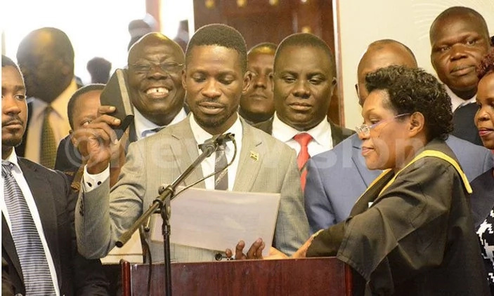 Bobi Wine being sworn in as an MP. Photo: The New Vision