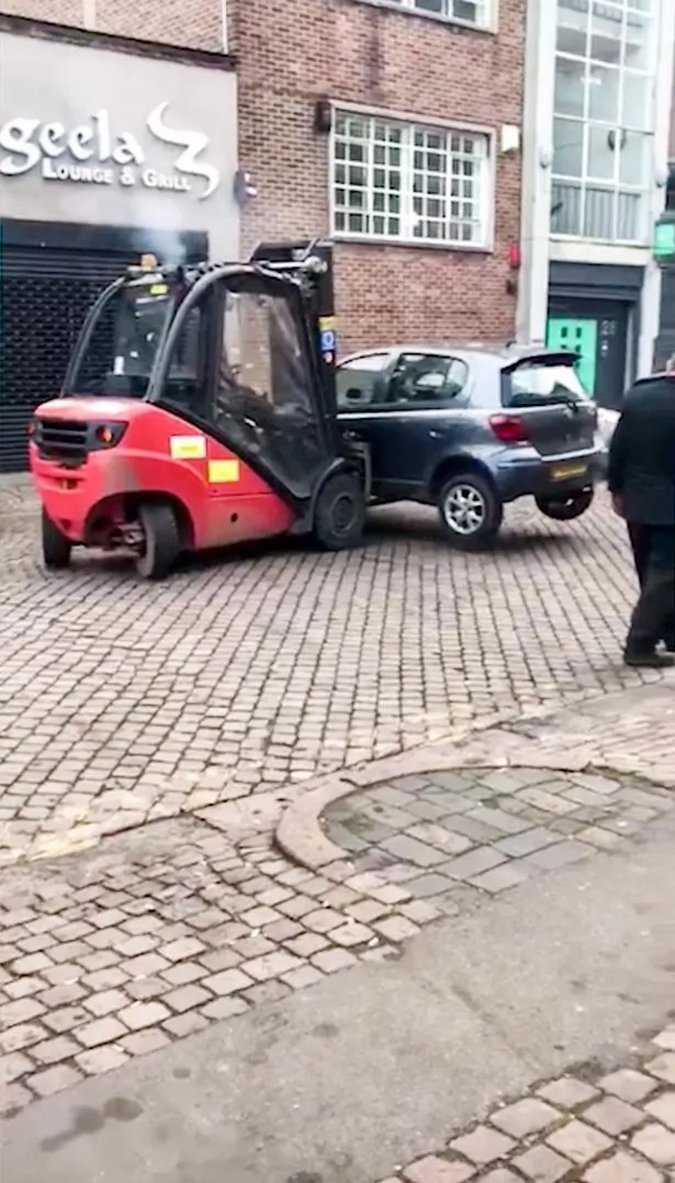 When a forklift comes in handy in more ways than one. Photo: YouTube/CGTN