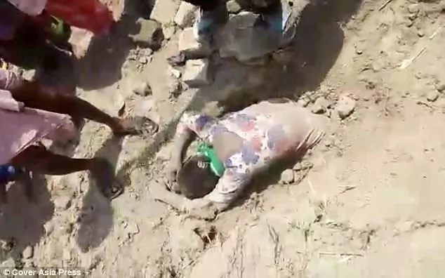 Girl, 19, is rescued after being buried alive because of family property dispute