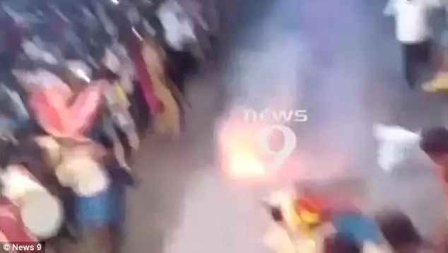 Priest stumbles and falls while running across FIERY coals during religious festival (photos, video)